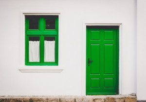 A green doored-house leading to a bath lift in North Devon